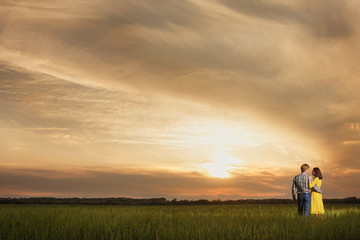Romantic silhouette of loving couple on beautiful red sky sunset