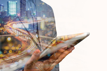 Double exposure of Business Man use Mobile SmartPhone with Urban