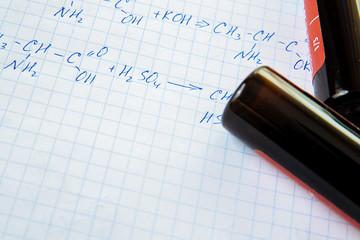Chemistry science formulas on white sheet