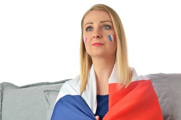 French soccer fan cheers football team in the national colors.