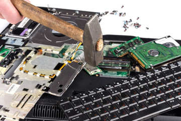 destroying laptop with a hammer