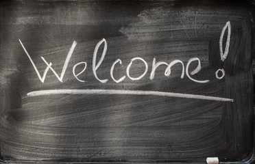 welcome on blackboard and chalks.