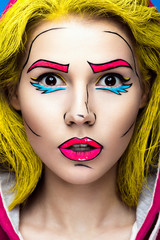 Photo of surprised young woman  with professional comic pop art make-up. Creative beauty style.