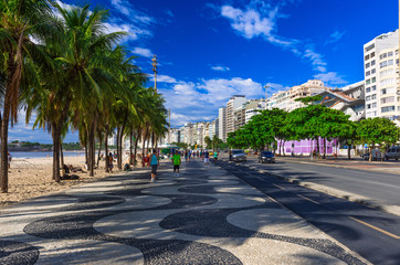 Copacabana with palms and mosaic of sidewalk in Rio de Janeiro. Brazil