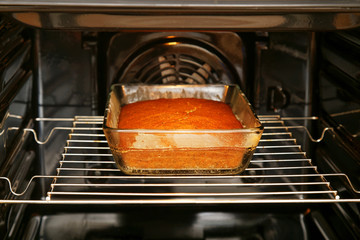 Sweet cake in open oven