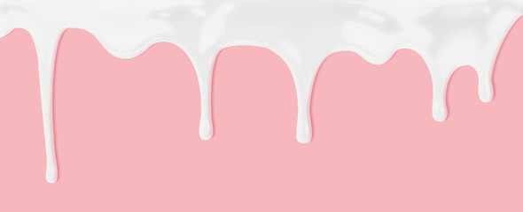 milk or white liquid dripping on pink background