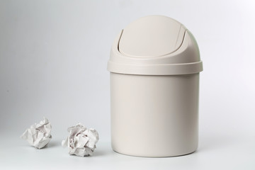 A wastepaper basket In front of a white background