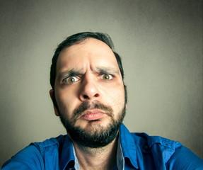 funny bearded man taking selfie shot