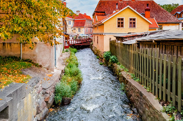 Rapid brook in old center of Kuldiga city, Latvia, Europe
