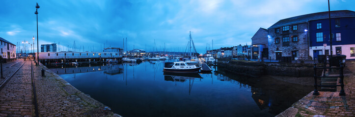 Panoramic view on marina quay in Plymouth, UK at sunrise.