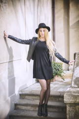 Beautiful young woman in black hat