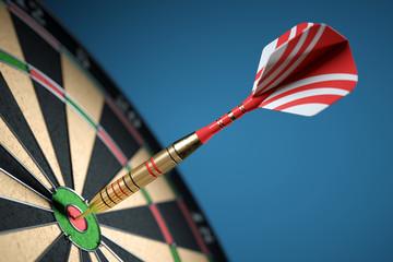 Dart in center of the target dartboard. Closeup.