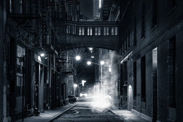 Acrylic Prints New York City Moody monochrome view of Staple street skybridge by night, in Tribeca, New York City