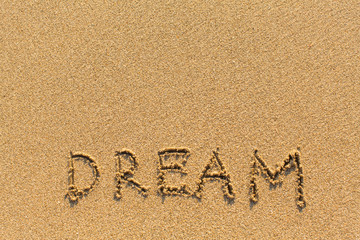 Dream - drawn of the hand on the beach sand.