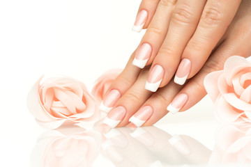 Photo sur Aluminium Manicure Woman hands with french manicure close-up