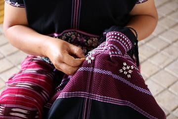 women hand sewing, Thailand