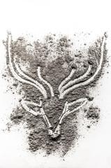 Deer head drawing in scattered ash