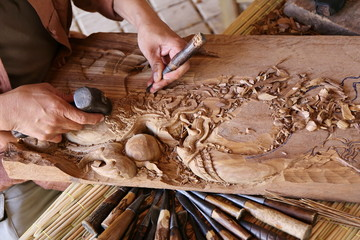 craftsman carving wood