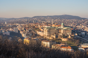 Buda Castle or Royal Palace in Budapest, Hungary Lit by Setting Sun