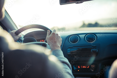 man driving car hand on steering wheel looking at the road ahead photo libre de droits sur. Black Bedroom Furniture Sets. Home Design Ideas
