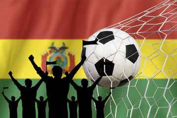 silhouettes of Soccer fans with flag of Bolivia.Cheer Concept