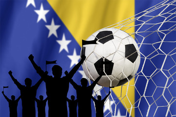 silhouettes of Soccer fans with flag of Bosnia and Herzegovina.C
