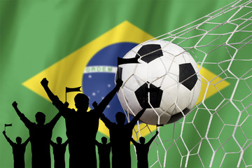 silhouettes of Soccer fans with flag of brazil .Cheer Concept