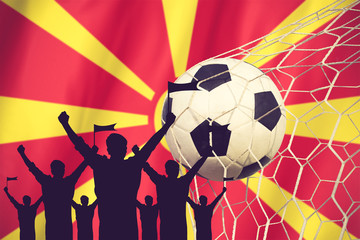 silhouettes of Soccer fans with flag of Macedonia .Cheer Concept