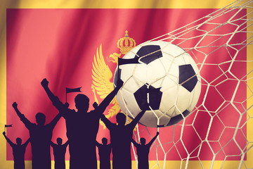 silhouettes of Soccer fans with flag of Montenegro .Cheer Concep