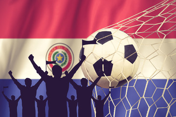 silhouettes of Soccer fans with flag of Paraguay .Cheer Concept