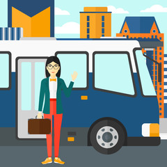 Woman standing near bus.