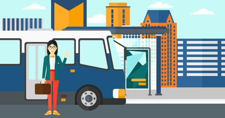 Woman standing near bus.