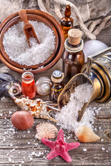 Essential oils and bath salt with a sea shells