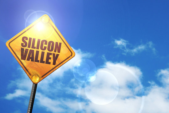 Yellow road sign with a blue sky and white clouds: silicon valle