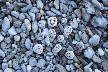 Smileys on pebbles