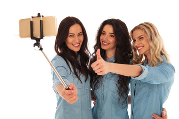 casual women taking a selfie and making the ok sign