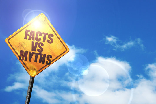 Yellow road sign with a blue sky and white clouds: facts vs myth
