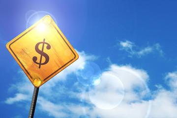 Yellow road sign with a blue sky and white clouds: dollar sign