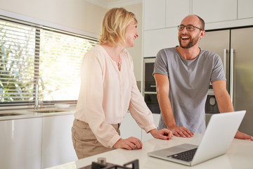 Couple in the kitchen with the laptop