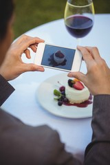 Woman taking a photo of her dessert