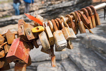 Group of old rusty padlocks, symbols of love. Cinque Terre, via dell'Amore (the way of love), Liguria, Italy