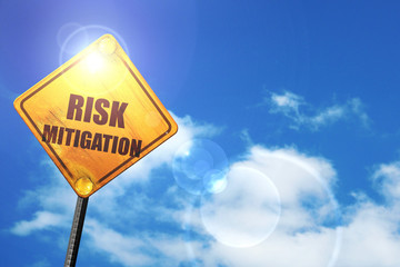 Yellow road sign with a blue sky and white clouds: Risk mitigati