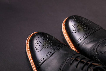 black oxford shoes with shoelace top view closeup