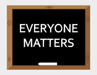 The words Everyone Matters written in white text on a blackboard with a stick of white chalk