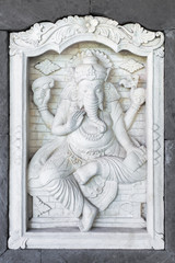 Stone sculpture of Ganesha god on the house wall in Bali