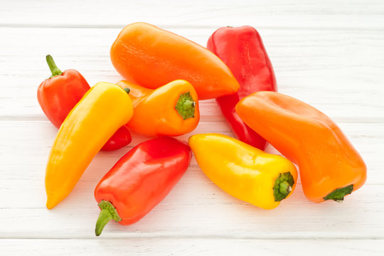 Colorful mini paprika on a white wooden table