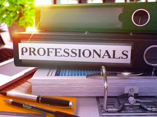 Professionals - Black Office Folder on Background of Working Table with Stationery and Laptop. Professionals Business Concept on Blurred Background. Professionals Toned Image. 3D.