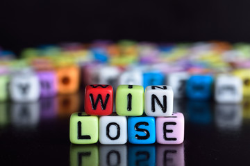 Win and lose on wooden table