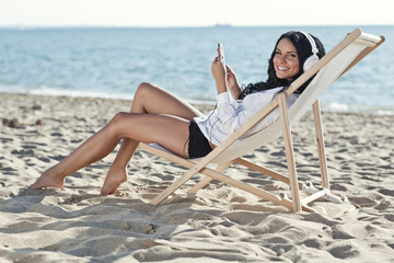 Woman are listening music on the beach