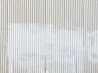 white wall of a metal gofrolist outdoors